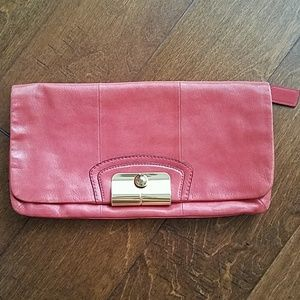 COACH leather clutch. Coral pink with gold closure